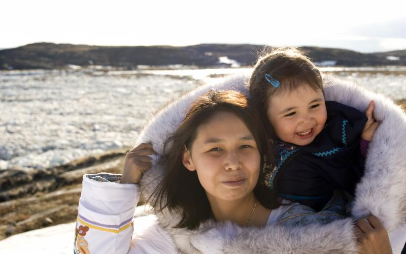 Inuit woman with child