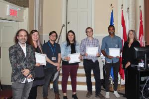 Douglas winners - left to right: Nicolas Cermakian (Director of Academic Affairs of the Research Centre), Lauren Reynolds, Santiago Cuesta, Chloé Nobis, Scott Bell, Abdelhalim Elsiekh, Brigitte Kieffer (Scientific Director of the Research Centre)